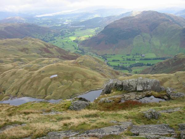 Langdale with Windermere in the distance from the top of Pavey Ark
