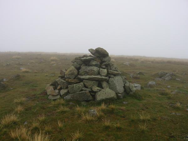 Gray Crag summit cairn and we are still in the cloud