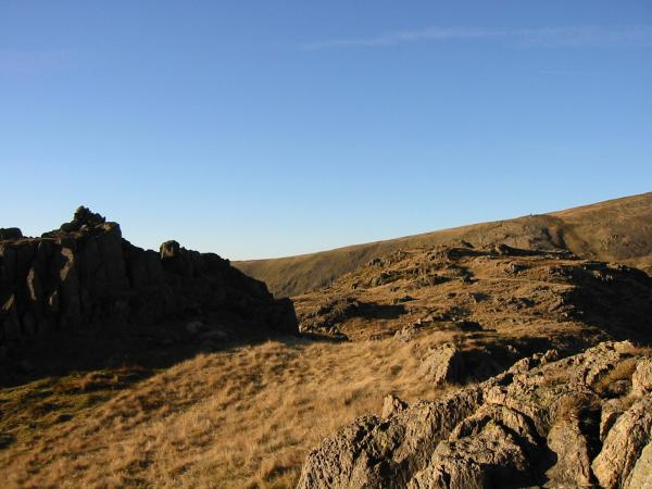 Looking to Little Hart Crag's south western and higher top from the cairn on the north eastern top