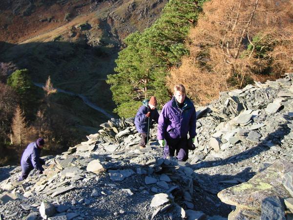 Ascending the spoil heap near the top of Castle Crag