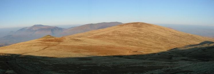 Calfhow Pike and Clough Head with the Skiddaw Fells and Blencathra behind from the climb up Great Dodd