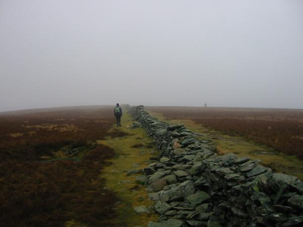 Following the wall to High Street's summit