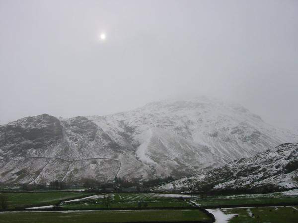 The sun trying to break through above Pike O' Blisco
