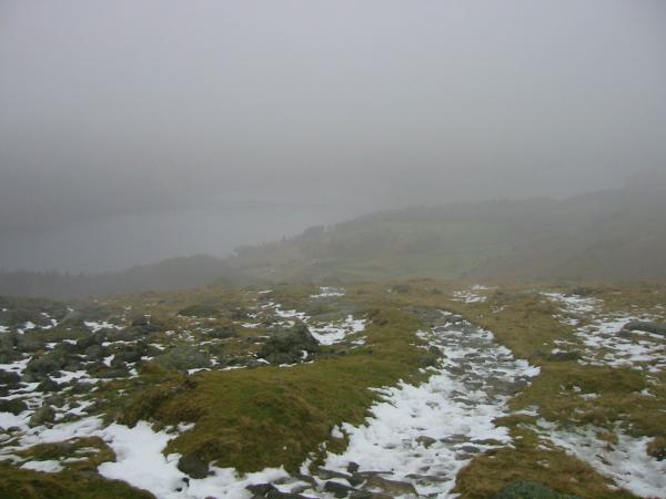 Thirlmere just visible as the path enters the cloud