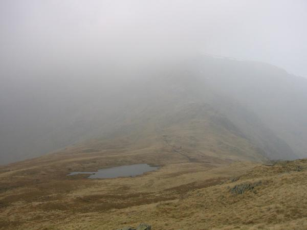 Caspel Gate Tarn and High Street in the gloom