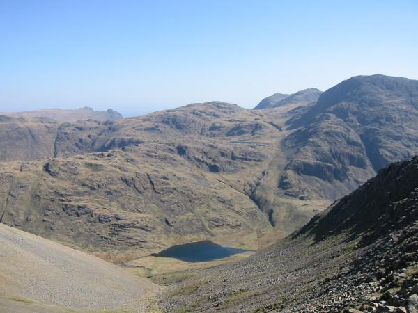 View east from Windy Gap - Langdale Pikes, Allen Crags, Bowfell, Esk Pike, Great End, Sprinkling Tarn and Styhead Tarn