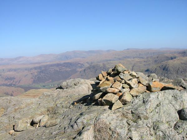 The Helvellyn range in the distance from Grey Knotts summit