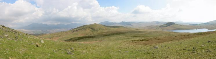 Looking back to Rough Crag and a panorama of the southern central Lakes from the route to Water Crag