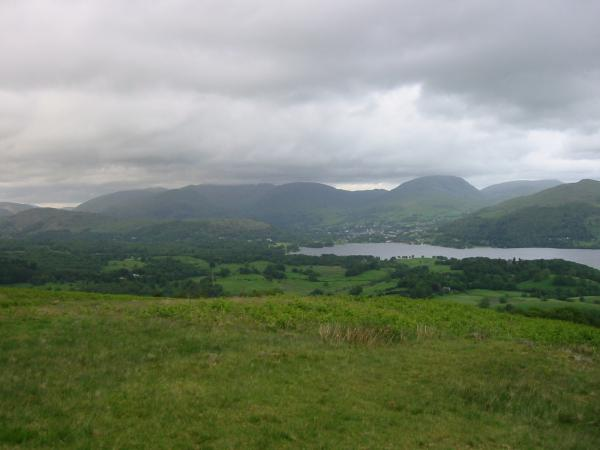 Loughrigg, Fairfield in cloud, Ambleside, Red Screes, Caudale Moor and Wandfell Pike from just north of the summit