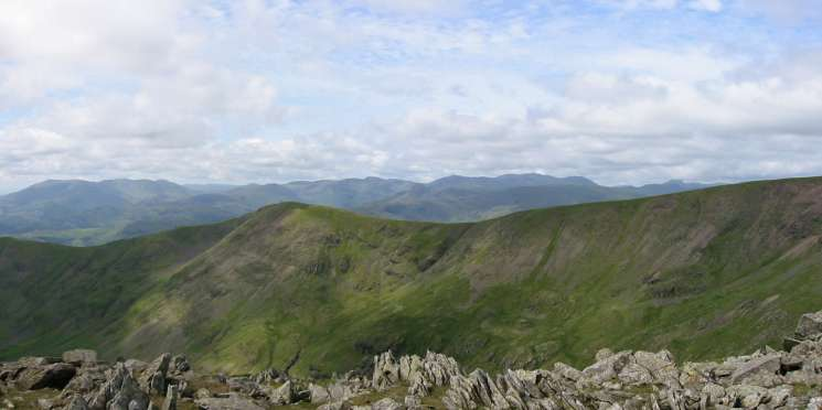 Looking west over Great Rigg to the high fells from Hart Crag's northwestern summit cairn