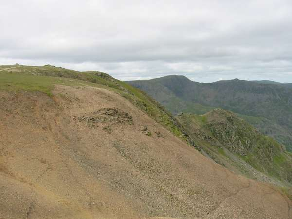 Fairfield's summit and Cofa Pike with Helvellyn and the point of Catstycam above Striding Edge in the distance