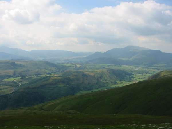 Looking down on High Rigg from Watson's Dodd with the Skiddaw Fells in the distance