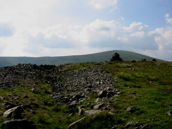 Hart Side's summit cairn and ditch with Great Dodd behind