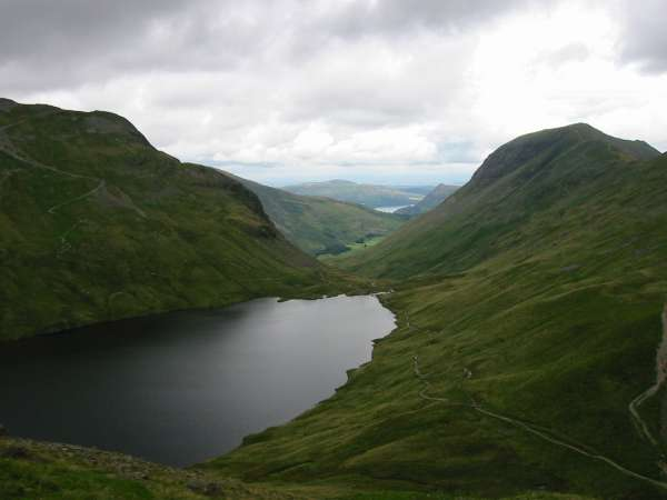 Dollywaggon Pike, Grisedale Tarn and Saint Sunday Crag with Ullswater in the distance from the climb up Seat Sandal