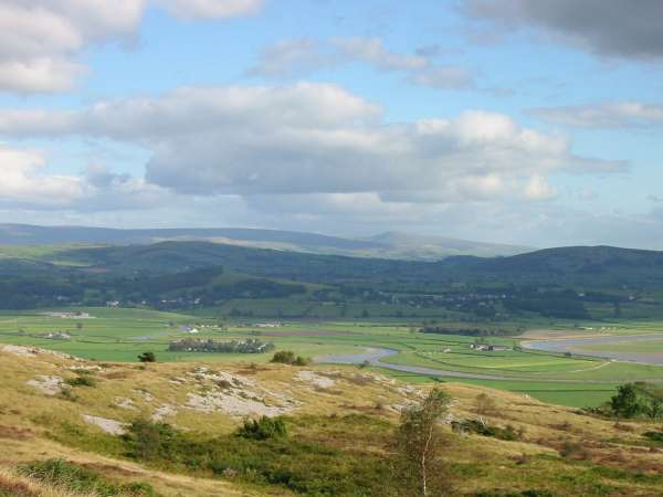The meandering River Kent with Ingleborough in the distance