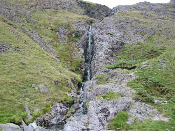 Cam Spout. The path climbs the slabs to the right of the waterfall