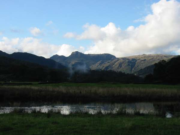 The Langdale Pikes now in sunshine from the River Brathay