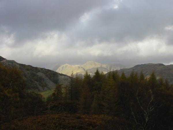 Floodlit Langdale Pikes seen on the descent off Holme Fell
