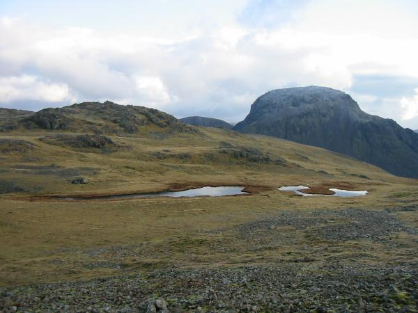 Kirk Fell's east top, Kirkfell Tarn (there are actually two tarns) and Great Gable