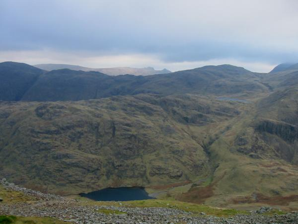 The Langdale Pikes in the distance behind the Glaramara to Allen Crags ridge from the descent to Sty Head off Great Gable