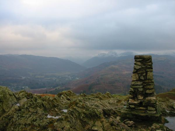 Snowy Langdale Pikes from Loughrigg Fell summit