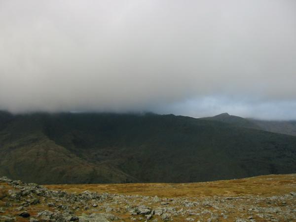 Helvellyn is lost in cloud. The pointed peak is Catstycam