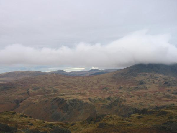 Looking northwest to Seatallan and Haycock with Slight Side lost in cloud, Hard Knott