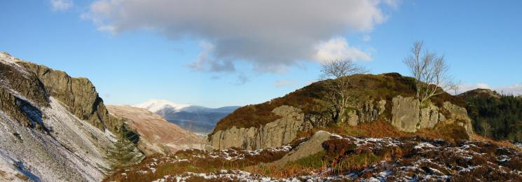Iron Crag, Skiddaw in the distance, Castle Crag Fort and The Benn