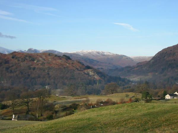 The Langdale Pikes and High Raise seen above part of Loughrigg Fell
