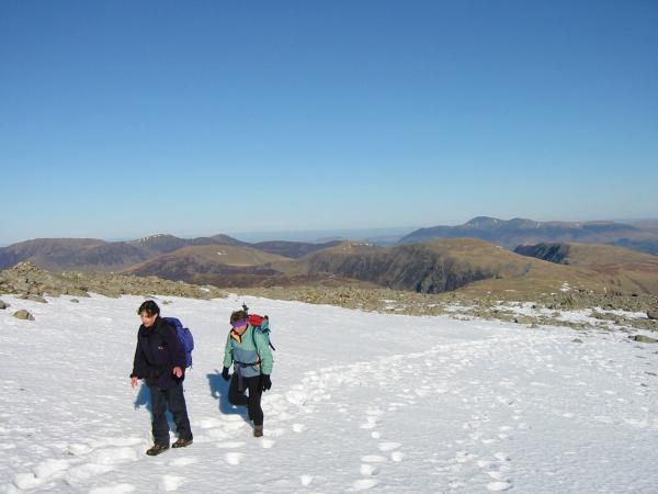 Crossing the snow to get to the summit rocks