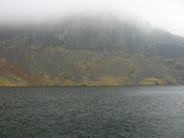 Pavey Ark lost in cloud across Stickle Tarn