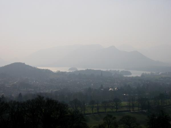 Looking south into the sun, very hazy. Castle Head, Derwent Water, Catbells and Keswick