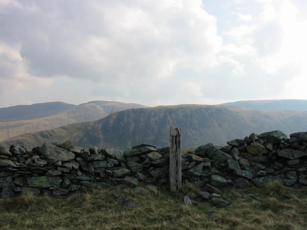 The wooden post marking the top of Hartsop Dodd with Gray Crag behind