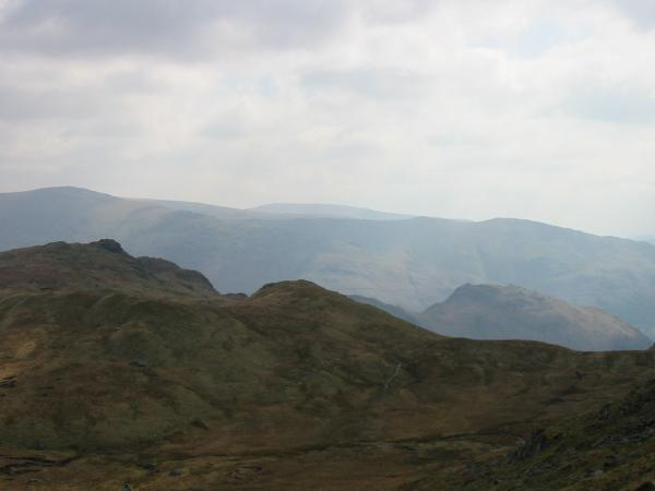 Calf Crag with Great Rigg behind on the left and the top of Helm Crag with Stone Arthur behind on the right