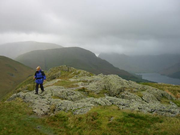 Ann on the ridge with High Snockrigg and Robinson behind