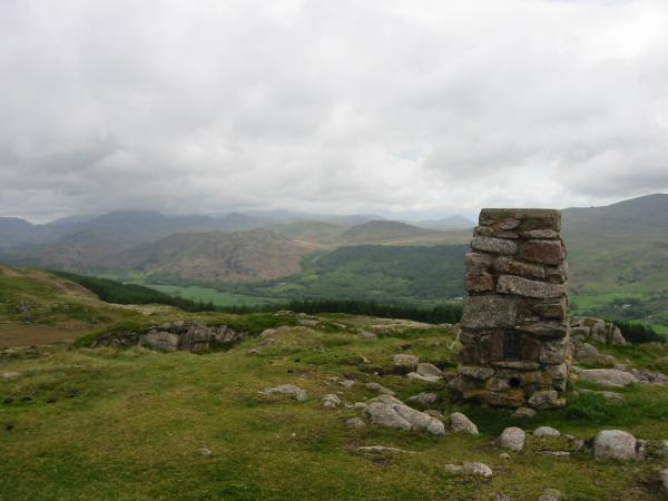 The Coniston Fells lost in cloud from the trig point