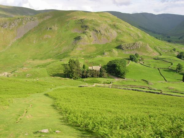Looking back down on St Peter's church, Martindale with Steel Knotts behind