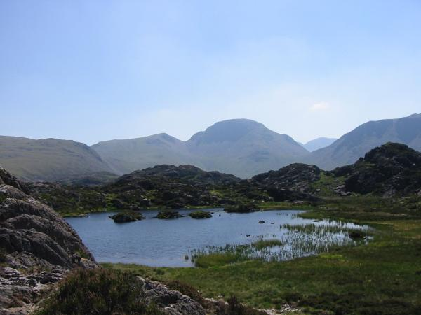 Looking across Innominate Tarn to Green Gable and Great Gable