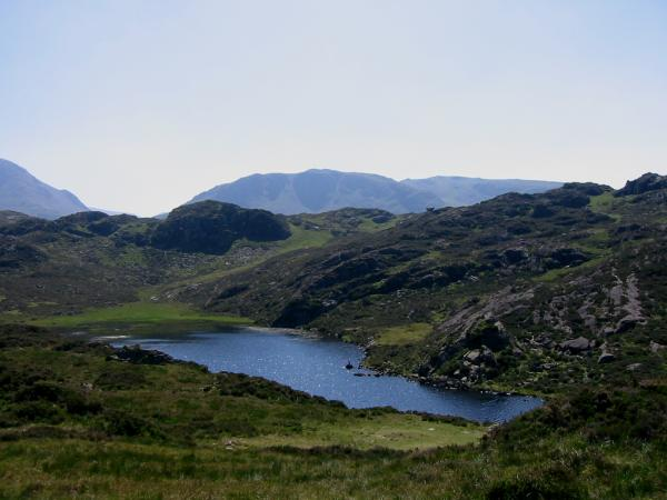 Looking back across Blackbeck Tarn to the perched boulder (right of centre on the near ridge)