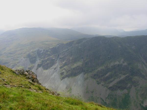 Honister Crag with Great Gable lost in cloud behind
