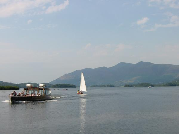 A launch approaches Lodore Landing Stage, Derwent Water