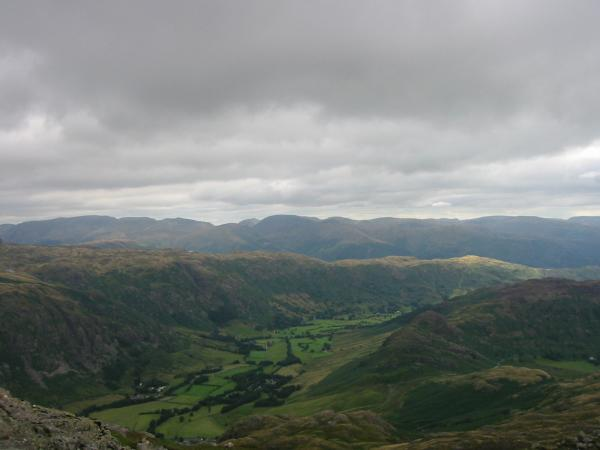 The view east from the summit. Great Langdale, the Blea Rigg ridge and the eastern fells