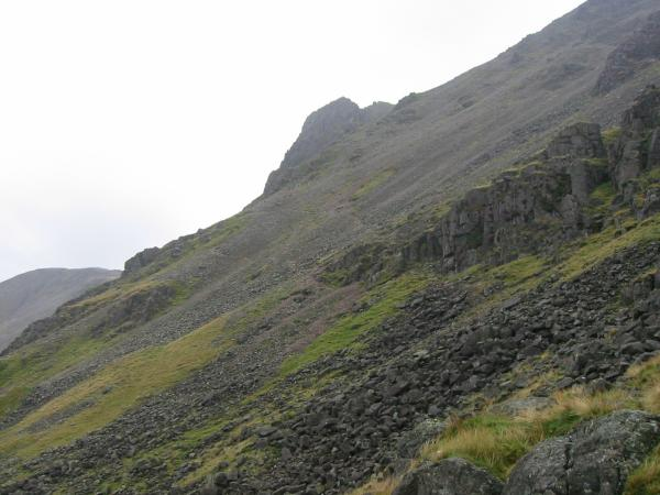 The traverse heads across to the bottom of The Great Napes, the cliffs in the distance