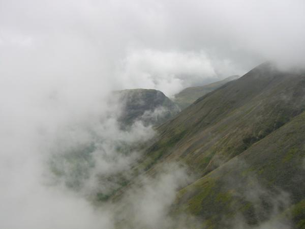 The flank of Kirk Fell and the north end of Yewbarrow seen through a break in the cloud
