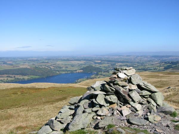 The wooded hill of Dunmallard near Pooley Bridge at the north end of Ullswater from Arthur's Pike's summit cairn