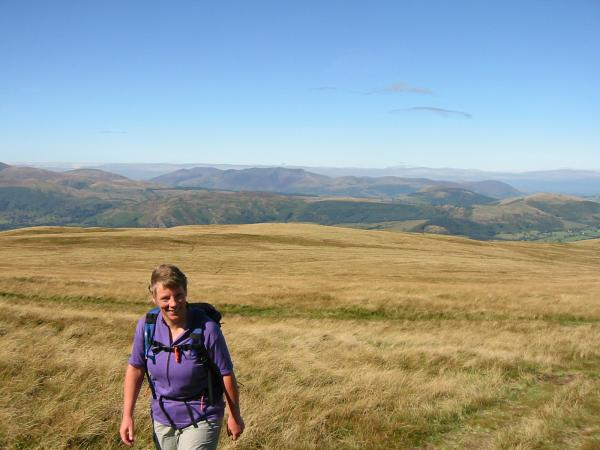 Anne Leaney heading for Loadpot Hill across the grass from Bonscale Pike