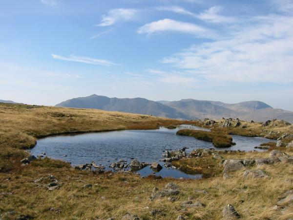 Bowfell, Esk Pike and Great End from the tarn on Thunacar Knott