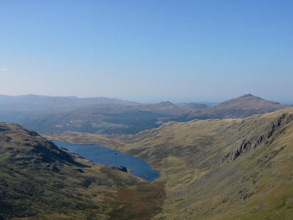 Seathwaite Fell with the conical Harter Fell on the right in the distance behind the southwest ridge of Grey Friar