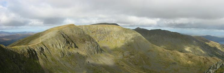 High Crag and Nethermost Pike in sunshine with Helvellyn, Catstycam and Striding Edge behind in shaddow