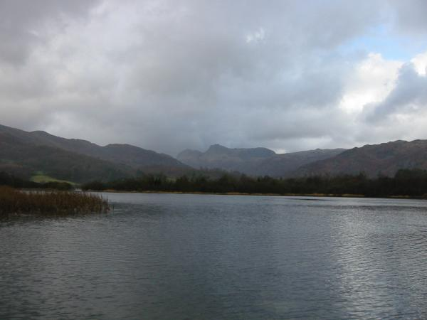 The Langdale Pikes seen across Elter Water